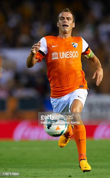 Duda of Malaga in action during the La Liga match between Valencia CF and Malaga CF at Estadio Mestalla on August 17 2013 in Valencia Spain