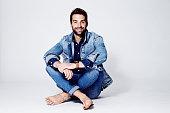 Man sitting in studio, smiling