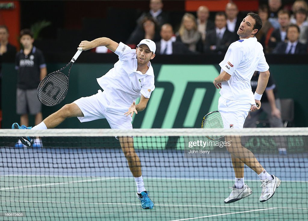 <a gi-track='captionPersonalityLinkClicked' href=/galleries/search?phrase=Dudi+Sela&family=editorial&specificpeople=553801 ng-click='$event.stopPropagation()'>Dudi Sela</a> (L) and <a gi-track='captionPersonalityLinkClicked' href=/galleries/search?phrase=Jonathan+Erlich&family=editorial&specificpeople=544067 ng-click='$event.stopPropagation()'>Jonathan Erlich</a> of Israel in action during their doubles match against Julien Bennetteau and Michael Llodra of France on day two of the Davis Cup first round match between France and Israel at the Kindarena stadium on February 2, 2013 in Rouen, France.