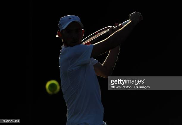 Dudi Sela in action against Marcel Granollers on day two of the Wimbledon Championships at The All England Lawn Tennis and Croquet Club Wimbledon