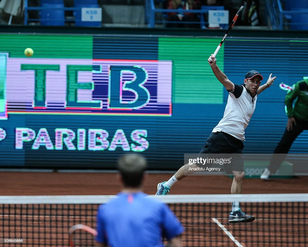 Dudi Sela (rear R) of Israel in action against Andres Molteni (R) of Argentina during the men's double match at the TEB BNP Paribas Istanbul Open tennis tournament at Koza World of Sports Arena in Istanbul, Turkey on May 01, 2016.