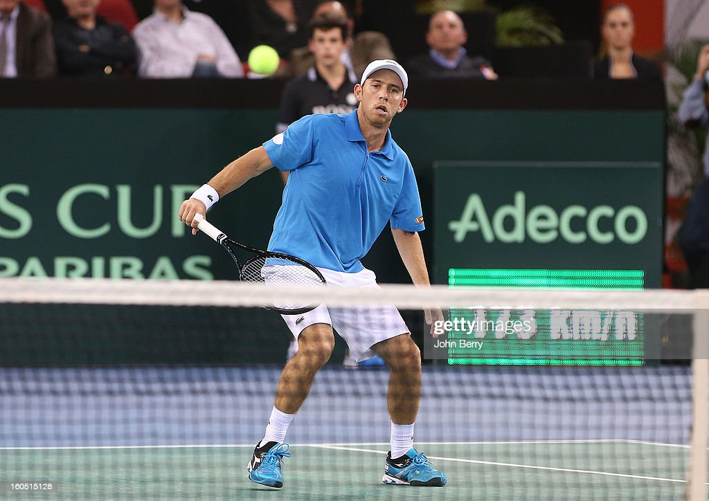 Dudi Sela of Israel plays a backhand against Richard Gasquet of France on day one of the Davis Cup first round match between France and Israel at the Kindarena stadium on February 1, 2013 in Rouen, France.
