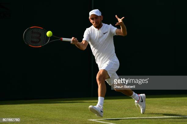 Dudi Sela of Israel plays a forehand during the Gentlemen's Singles first round match against Marcel Granollers of Spain on day two of the Wimbledon...