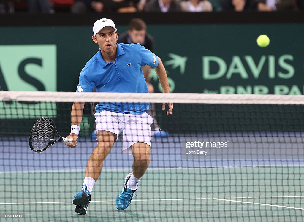 Dudi Sela of Israel plays a volley against Richard Gasquet of France on day one of the Davis Cup first round match between France and Israel at the Kindarena stadium on February 1, 2013 in Rouen, France.