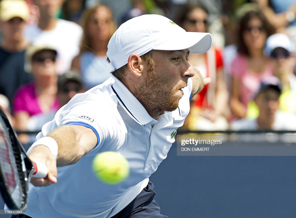Dudi Sela of Israel returns the ball to Janko Tipsarevic of Serbia during their US Open 2013 men's singles match at the USTA Billie Jean King National Center August 29, 2013 in New York. AFP PHOTO/Don Emmert