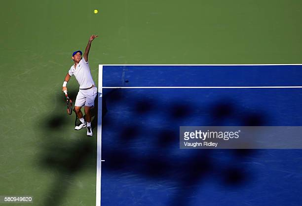 Dudi Sela of Isreal serves against John Isner of the USA during Day 1 of the Rogers Cup at the Aviva Centre on July 25 2016 in Toronto Ontario Canada