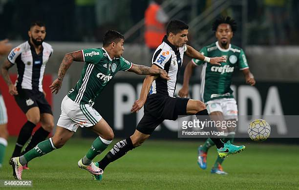 Dudu and Ze Roberto of Palmeiras fights for the ball with Renato of Santos during the match between Palmeiras and Santos for the Brazilian Series A...