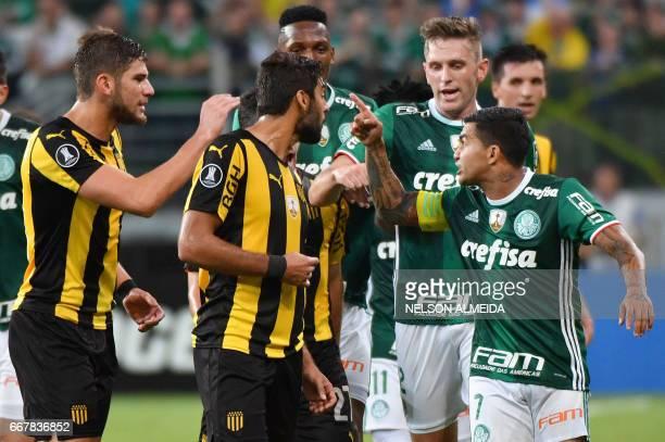 Dudu of Brazil´s Palmeiras argues with Yefferson Quintana of Uruguay's Penarol during their 2017 Copa Libertadores football match held at Allianz...
