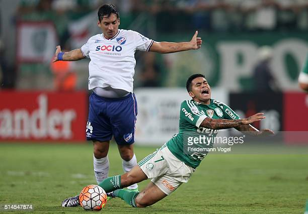 Dudu of Palmeiras fights for the ball with Gonzalo Porras of Nacional during a match between Palmeiras and Nacional as part of Group 2 of Copa...