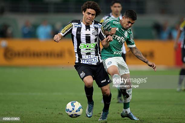 Dudu of Palmeiras fights for the ball with Victor Ferraz of Santos during the match between Palmeiras and Santos for the Copa do Brasil 2015 Final at...