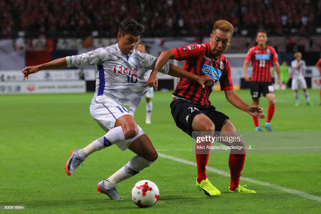 Dudu of Ventforet Kofu and Akito Fukumori of Consadole Sapporo compete for the ball during the J.League J1 match between Consadole Sapporo and Ventforet Kofu at Sapporo Dome on August 13, 2017 in Sapporo, Hokkaido, Japan.