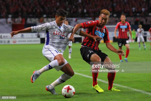 Dudu of Ventforet Kofu and Akito Fukumori of Consadole Sapporo compete for the ball during the JLeague J1 match between Consadole Sapporo and...