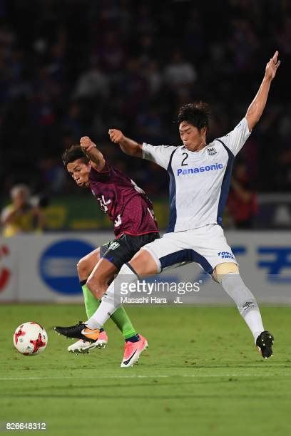 Dudu of Ventforet Kofu and Genta Miura of Gamba Osaka compete for the ball during the JLeague J1 match between Ventforet Kofu and Gamba Osaka at...