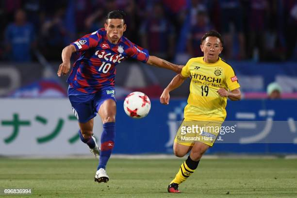Dudu of Ventforet Kofu and Hiroto Nakagawa of Kashiwa Reysol compete for the ball during the JLeague J1 match between Ventforet Kofu and Kashiwa...