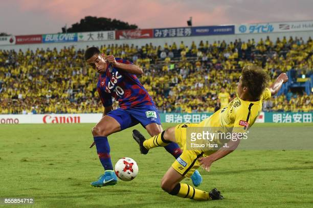 Dudu of Ventforet Kofu and Junya Ito of Kashiwa Reysol compete for the ball during the JLeague J1 match between Kashiwa Reysol and Ventforet Kofu at...