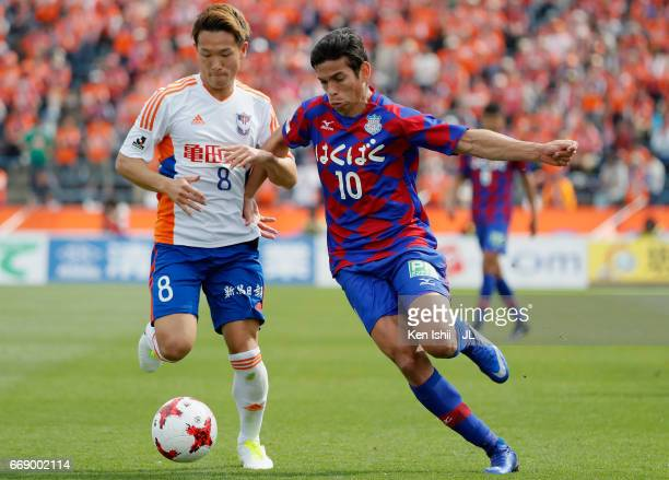 Dudu of Ventforet Kofu and Kei Koizumi of Albirex Niigata compete for the ball during the JLeague J1 match between Ventforet Kofu and Albirex Niigata...