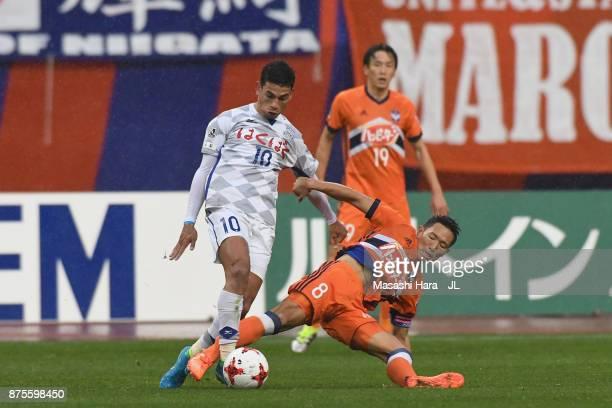 Dudu of Ventforet Kofu and Kei Koizumi of Albirex Niigata compete for the ball during the JLeague J1 match between Albirex Niigata and Ventforet Kofu...