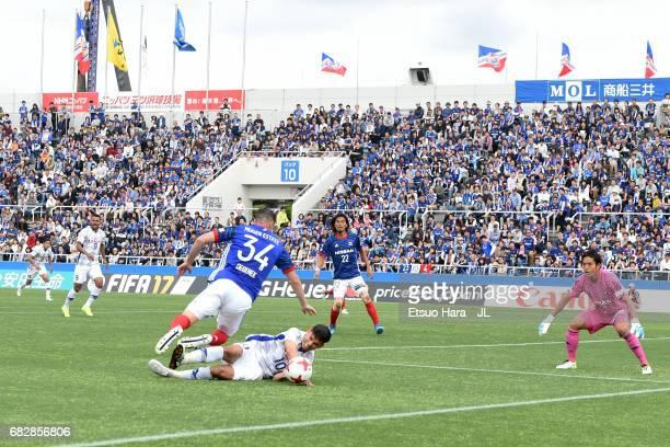 Dudu of Ventforet Kofu and Milos Degenek of Yokohama FMarinos compete for the ball during the JLeague J1 match between Yokohama FMarinos and...