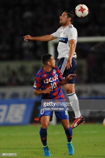 Dudu of Ventforet Kofu and Milos Degenek of Yokohama FMarinos compete for the ball during the JLeague J1 match between Ventforet Kofu and Yokohama...