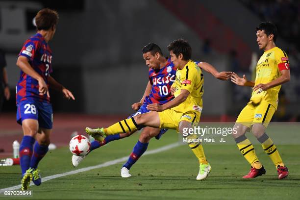 Dudu of Ventforet Kofu and Naoki Wako of Kashiwa Reysol compete for the ball during the JLeague J1 match between Ventforet Kofu and Kashiwa Reysol at...