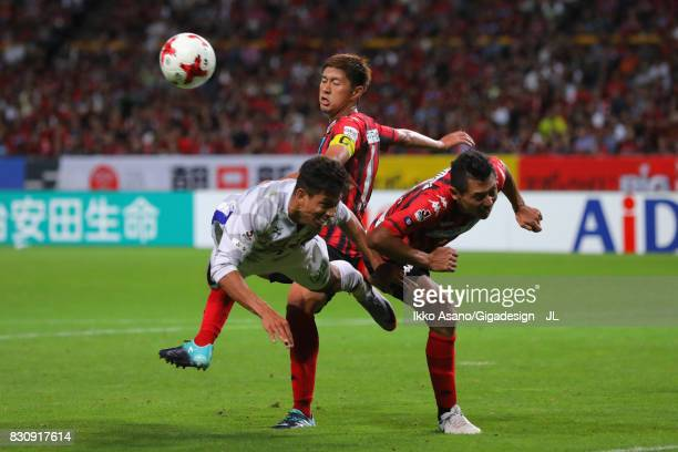 Dudu of Ventforet Kofu and Ryuji Kawai of Consadole Sapporo compete for the ball during the JLeague J1 match between Consadole Sapporo and Ventforet...