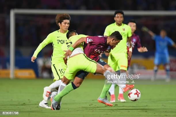 Dudu of Ventforet Kofu and Tomoaki Makino of Urawa Red Diamonds compete for the ball during the JLeague J1 match between Ventforet Kofu and Urawa Red...