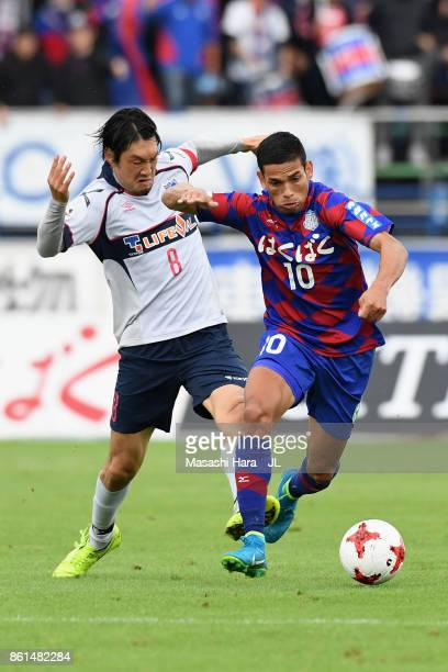 Dudu of Ventforet Kofu and Yojiro Takahagi of FC Tokyo compete for the ball during the JLeague J1 match between Ventforet Kofu and FC Tokyo at...