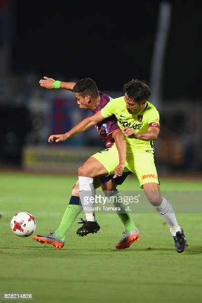 Dudu of Ventforet Kofu and Yuki Abe of Urawa Red Diamonds compete for the ball during the JLeague J1 match between Ventforet Kofu and Urawa Red...