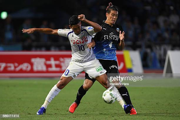 Dudu of Ventforet Kofu and Yusuke Igawa of Kawasaki Frontale compete for the ball during the JLeague match between Kawasaki Frontale and Ventforet...