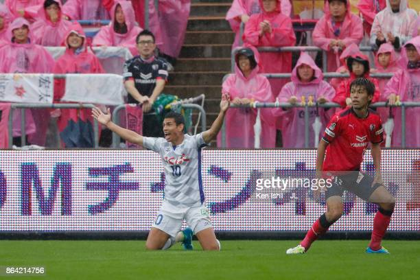 Dudu of Ventforet Kofu appeals to referee after tackled by Yasuki Kimoto of Cerezo Osaka during the JLeague J1 match between Cerezo Osaka and...