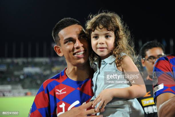 Dudu of Ventforet Kofu applauds supporters with his daughter after their 32 victory during the JLeague J1 match between Ventforet Kofu and Yokohama...