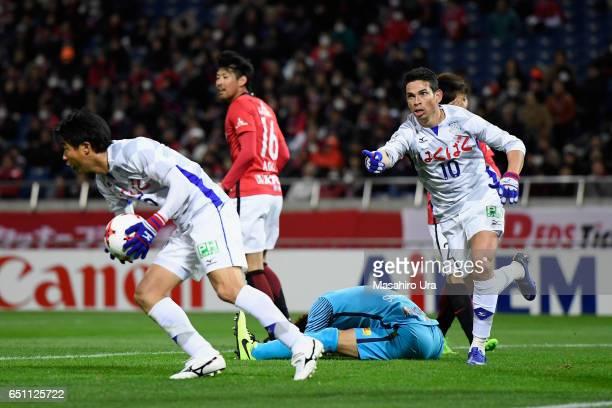 Dudu of Ventforet Kofu celebrates scoring his side's first goal during the JLeague J1 match between Urawa Red Diamonds and Ventforet Kofu at Saitama...