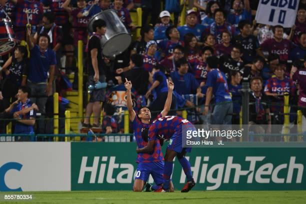 Dudu of Ventforet Kofu celebrates scoring the opening goal during with his team mate Lins the JLeague J1 match between Kashiwa Reysol and Ventforet...
