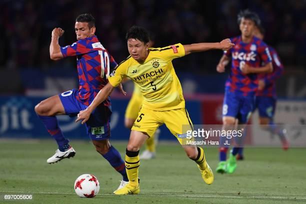 Dudu of Ventforet Kofu controls the ball under pressure of Yuta Nakayama of Kashiwa Reysol during the JLeague J1 match between Ventforet Kofu and...