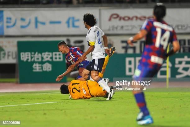 Dudu of Ventforet Kofu is challenged by Hiroki Iikura of Yokohama FMarinos resulting in a penalty kick during the JLeague J1 match between Ventforet...