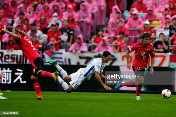 Dudu of Ventforet Kofu is tackled by Souza of Cerezo Osaka during the JLeague J1 match between Cerezo Osaka and Ventforet Kofu at Kincho Stadium on...
