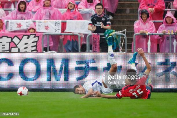 Dudu of Ventforet Kofu is tackled by Yasuki Kimoto of Cerezo Osaka during the JLeague J1 match between Cerezo Osaka and Ventforet Kofu at Kincho...