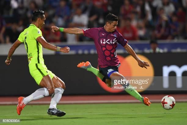Dudu of Ventforet Kofu shoots at goal while Tomoaki Makino of Urawa Red Diamonds tries to block during the JLeague J1 match between Ventforet Kofu...