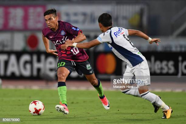 Dudu of Ventforet Kofu takes on Yosuke Ideguchi of Gamba Osaka during the JLeague J1 match between Ventforet Kofu and Gamba Osaka at Yamanashi Chuo...
