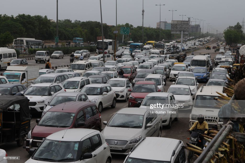 Due to construction work of underpass at Rajiv Chowk, Gurgaon traffic police divert the traffic causes traffic jam, on June 19, 2017 in Gurgaon, India. With just one night of rain, several internal roads and at major intersections such as Huda City Centre, Signature Tower Road, Hero Honda Chowk and Iffco Chowk were waterlogged, delaying commuters, especially officegoers.
