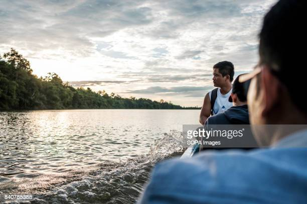 Due to heavy security union activists access the Lower Sesan II Dam site by fishing boat It's the only way to see the dam Local communities refuse to...