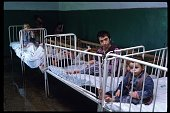 Due to overcrowding some beds are occupied by two children May 15 1990 in Romania Under Nicolae Ceausescu policies women were required to bear at...