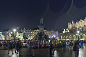 Due to the rain there are only a few pilgrims around Krakow's Main Square on the opening WYD 2016 evening On Tuesday 26 July 2016 in Krakow Poland