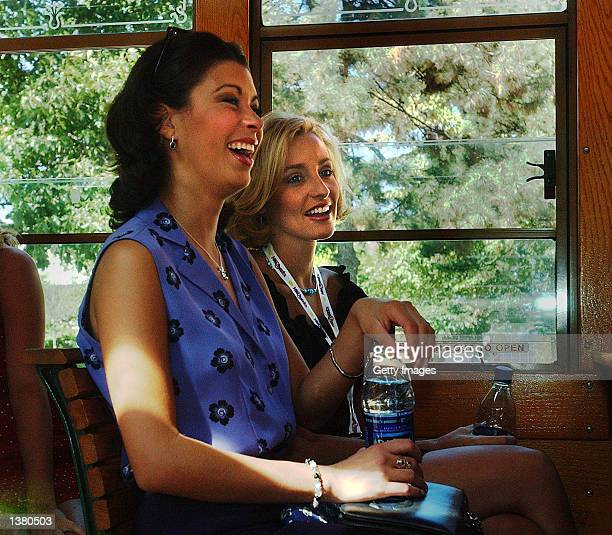 Dueling dual Miss North Carolinas Rebekah Revels and Misty Clymer sit side by side on a trolley trip to Drexel University September 7 2002 in...