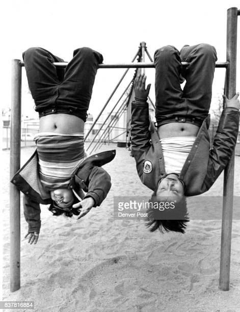 Dueling Navels Che Ramirez and Arthur Romero both age 10 hang upside down on chinup bars at Greenlee Elementary on a recent springlike afternoon...