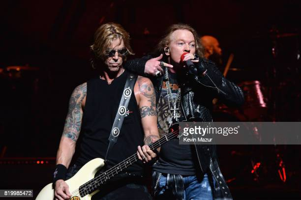 Duff McKagan and Axl Rose of Guns N' Roses perform onstage during SiriusXM's Private Show with Guns N' Roses at The Apollo Theater before band...