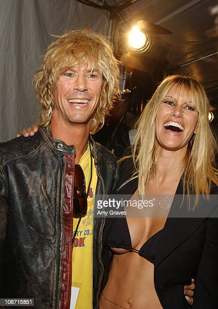 Duff McKagan and Susan Holmes during 2003 Smashbox Fashion Week Los Angeles Susan Holmes Spring Collection 2004 Backstage at Smashbox Studios in...