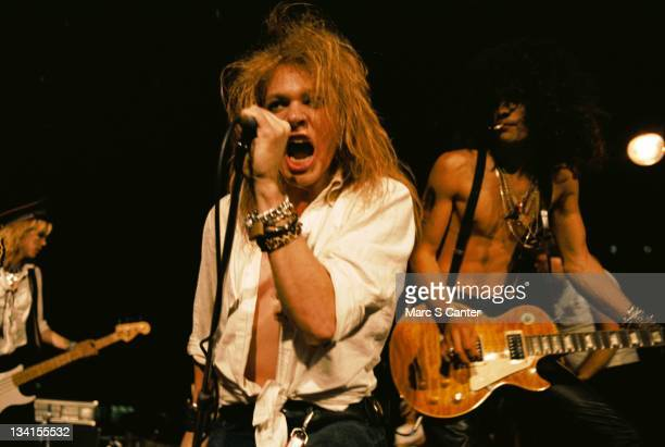 Duff McKagan Axl Rose and Slash of the rock group 'Guns n' Roses' perform at the LA Street Scene on September 28 1985 in Los Angeles California Slash...