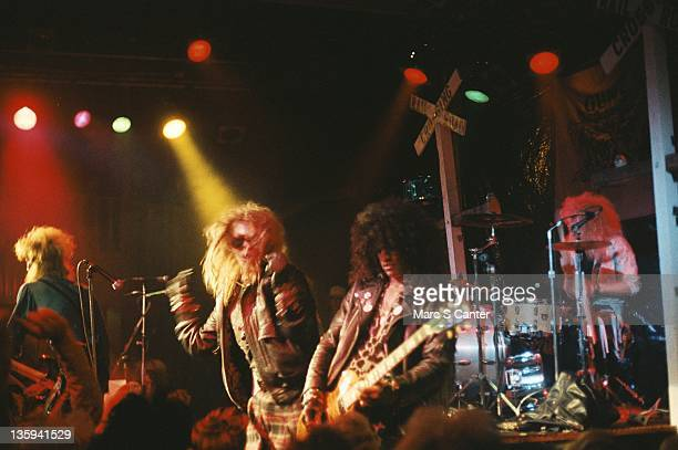 Duff McKagan Axl Rose Slash and Steven Adler of the rock band 'Guns n' Roses' perform onstage at the Troubadour on the night that Tom Zutaut of...