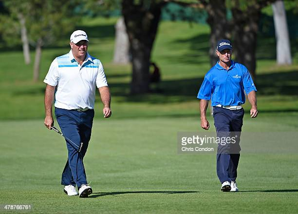 Duffy Waldorf and Bill Glasson walk up the 9th fairway during the first round of the Champions Tour Toshiba Classic at Newport Beach Country Club on...